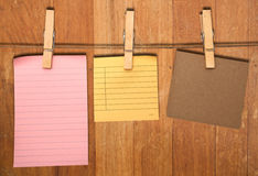Close up of a notes and a clothes pegs Royalty Free Stock Image
