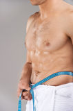 Close up of nude male torso in white towel. Stock Images