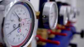 Close-up of number of pressure gauges. Pressure gauges are devices that measure pressure of liquid or gas in pipes at. Enterprises of power engineering stock video