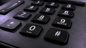 Close up on the numbers on the keypad phone, fixed phone Royalty Free Stock Photos