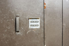 Close up of numerical combination lock at entrance royalty free stock photography