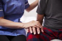 Close Up Of Nurse Comforting Senior Man On Home Visit royalty free stock photos