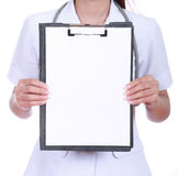 Close-up nurse  holding a blank clipboard Royalty Free Stock Image