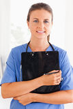 Close up of a nurse holding a folder Royalty Free Stock Images