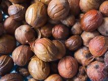 Close up of nutmeg seeds. Close up of pile of nutmeg seeds, Balik Pulau, Penang, Malaysia Stock Image