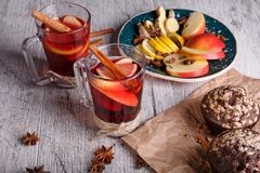 Aromatic, hot red tea with apples and sweet muffins on a table background. Healthy breakfast. Stock Images