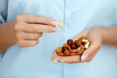 Close Up Of Nuts In Woman Hands. royalty free stock images