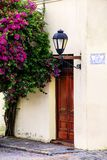 Close-up o a building with a street lamp and bougainvillea tree royalty free stock photography