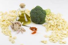 Close-up o f ingredients of typical italian recipe orecchiette ai broccoli: handmade durum wheat flour pasta orecchiette, broccoli stock photography