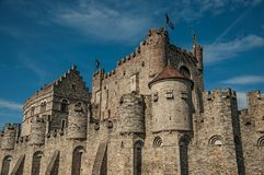 Close-up o stone wall and watch-tower of the Gravensteen Castle in Ghent. stock image