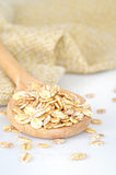 Close up of oat flakes in wooden spoon Royalty Free Stock Images