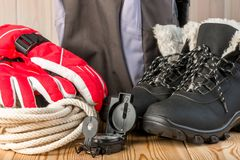Close-up objects and clothes for a winter hike on a wooden Royalty Free Stock Photography