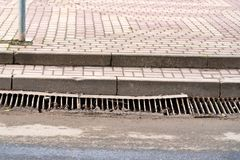 Storm drain on road Stock Photography