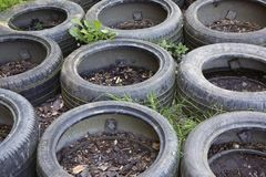 Old car tires used at an obstacle course. A close-up of an obstacle course where old car tires are being used as one of the obstacles stock images