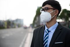 Free Close Up Of A Businessman In A Suit Wearing Protective Face Mask And Cough, Get Ready For Coronavirus And Pm 2.5 Fighting Against Royalty Free Stock Photos - 174830208