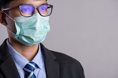 Free Close Up Of A Businessman In A Suit Wearing Protective Face Mask, Get Ready For Coronavirus And Pm 2.5 Fighting Against Gray Stock Images - 177085754