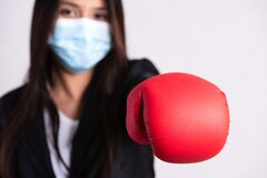 Free Close Up Of A Businesswoman In A Suit Wearing Red Boxing Gloves And Protective Face Mask, Get Ready For Coronavirus And Pm 2.5 Royalty Free Stock Image - 177085786