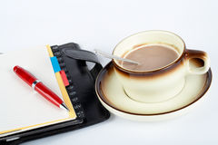 Free Close-up Of A Cup Of Coffee With The Spoon Inside And Notebook With Ballpoint Stock Photo - 908110