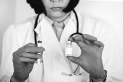 Free Close Up Of A Doctor In White Lab Coat And Sterile Gloves Holding Syringe And Medicine In Ampoule Stock Image - 176836151