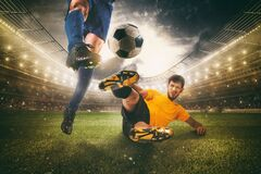 Free Close Up Of A Football Action Scene With Competing Soccer Players At The Stadium Royalty Free Stock Image - 214415506
