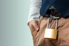Free Close-up Of A Gold Padlock Hanging From A Man`s Belt. The Concept Of Marital Fidelity, Celibacy, Treason, Chastity Belt Stock Photos - 203373243