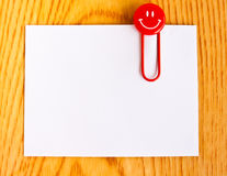 Close Up Of A Red Paper Clip And White Paper Stock Image