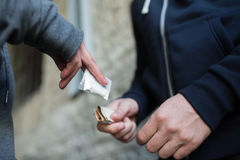 Free Close Up Of Addict Buying Dose From Drug Dealer Stock Images - 75799074