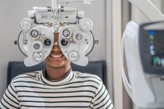 Free Close-up Of African Teen Girl Doing Eye Test On Phoropter, African Teen Girl Checking On Her Eye With Optometry Machine Stock Image - 217118491