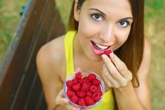 Close Up Of Beautiful Sexy Woman Eating Berries In The Park Royalty Free Stock Photography