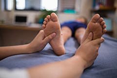 Free Close-up Of Boy Receiving Foot Massage From Female Therapist Stock Image - 96124511