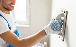 Close Up Of Builder Working With Grinding Tool Royalty Free Stock Photos