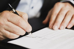 Close Up Of Businessman Signing A Contract. Royalty Free Stock Photography