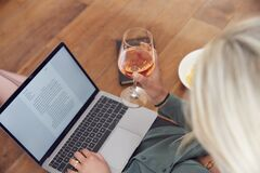 Free Close Up Of Businesswoman At End Of Day With Wine In Loungewear And Suit On Laptop Working At Home Royalty Free Stock Images - 208528279