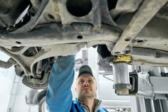 Free Close Up Of Car`s Bottom With Man Who Checking Transmission Stock Images - 163970564