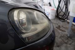 Free Close Up Of Dirty Yellow Car Headlight In The Shop Royalty Free Stock Images - 161604929