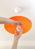 Close-up Of Energy-saving LED Light Bulb In The Human Hand, The Replacement Of The Lamp In The Ceiling Luminaire