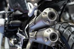 Free Close-up Of Exhaust Or Intake Of Black Sport Racing Motorcycle With New Tire And Wheel In Showroom. Low Angle Photograph Of Royalty Free Stock Image - 165870806