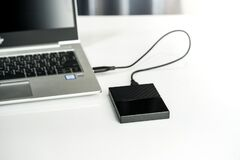 Free Close Up Of External Hard Disk Drive For Connect To Laptop, Transfer Or Backup Data Between Computer And HDD Royalty Free Stock Photography - 174181417