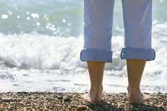 Close Up Of Female Feet On Beach Stock Photography