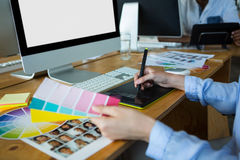 Free Close-up Of Female Graphic Designer Using Graphics Tablet At Desk Royalty Free Stock Photography - 95477647