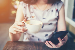 Free Close Up Of Hand Woman Using Phone In Coffee Shop With Depth Of Stock Image - 79705321