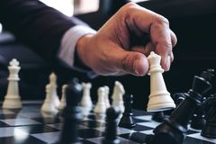 Free Close Up Of Hands Confident Businessman Colleagues Playing Chess Royalty Free Stock Images - 102230379