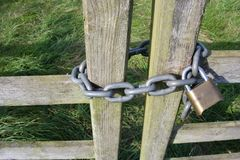 Free Close Up Of Locked Chain Around A Closed Wooden Gate Royalty Free Stock Image - 159293416
