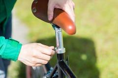 Free Close Up Of Man Adjusting Fixed Gear Bike Saddle Stock Photo - 66926270