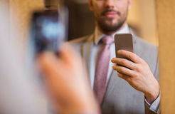 Free Close Up Of Man In Suit Taking Mirror Selfie Stock Images - 71915254