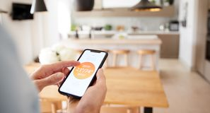 Free Close Up Of Man Using App On Smart Phone To Control Central Heating Temperature In House Stock Photography - 163726632