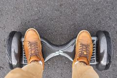 Free Close Up Of Man Using Hoverboard On Asphalt Road. Feet On Electrical Scooter Outdoor, Top View Royalty Free Stock Image - 162199286
