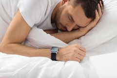 Free Close Up Of Man With Smart Watch Sleeping In Bed Stock Image - 142971311