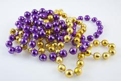 Close Up Of Mardis Gras Beads Royalty Free Stock Photos