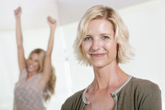 Close Up Of Mother With Excited Daughter Raising Hands Stock Images